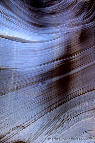 Abstract photograph of streaked, textured sandstone in a slot canyon
