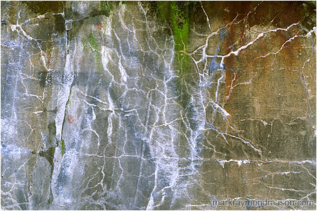 Cracked Concrete: Vancouver, BC, Canada (2005) - Abstract photograph showing graffiti and patterned cracks in concrete wall
