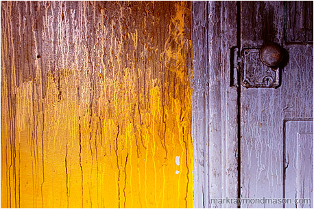 Abstract photograph of stained water streams on the colourful interior of a burned-out house