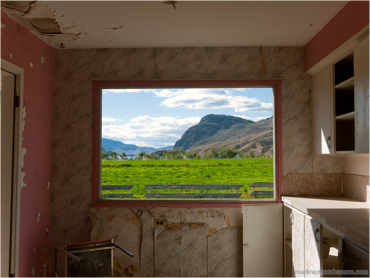 Broken Room, Picture Window: Near Kamloops, BC, Canada (2012-09-03) - Fine art photograph of a window in a derelict house with missing glass but a beautiful pastoral and mountain view