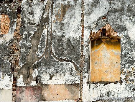 Fine art photo showing a wall next to a demolished structure, the missing adjoining walls clearly visible
