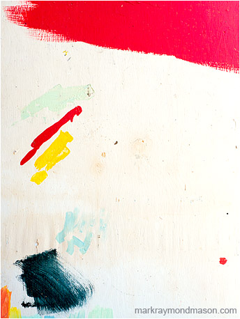 Abstract fine art photograph showing brightly coloured brush strokes on a white concrete wall